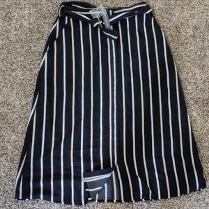 The limited, pin stripe knee length skirt
